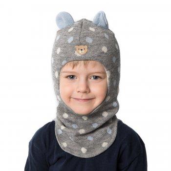 Шлем (серый в бело-голубой горох с ушками)Одежда<br>Описание<br>Шлемы Киват очень теплые и подойдут на самые лютые морозы. Специальные вставки с утеплителем в области ушек и лба. Отличная посадка по голове и оригинальный дизайн. Светоотражающие вставки для безопасности.<br>Характеристики:<br>Верх: 100% шерсть<br>Подкладка: 100% хлопок<br>Шлемы Киват очень теплые и подойдут на самые лютые морозы. Специальные вставки с утеплителем в области ушек и лба. Отличная посадка по голове и оригинальный дизайн. Светоотражающие вставки для безопасности. <br>Производитель: Kivat, Финляндия<br>Коллекция Осень/Зима 2017<br>Модель производится в размерах 0-2<br>Страна производства: Финляндия<br>Температурный режим<br>От 0 до -20 градусов; Размеры в наличии: 0, 1, 2.<br>